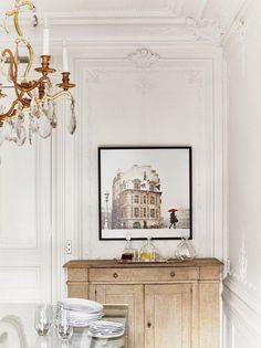 Elegant and rustic - Parisian chic decor with lavish chandelier and rustic wood cabinet