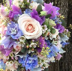 Purple, pink and light blue pastel wedding bouquet made by Forget-me-not Floret. Check out https://www.facebook.com/forgetmenotfloret/