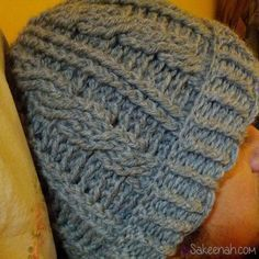 If you are looking for a nice free crochet pattern for a cable hat, check out Sarah Arnold's Cable Hat pattern. The pattern calls for front post double and treble crochet (fpdc and fptr) as well as back post double crochet (bpdc). Here is the first cable hat I made for hubby with this pattern. I used Patons Superwash DK in grey. He says it came out super warm and still hasn't started wearing it yet. He said he's reserving it for true winter weather. I found the best price for Patons Class…
