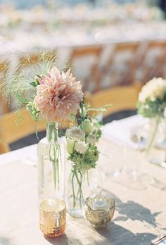 Brides.com: . Budget-Friendly Buds. Place single-stem flowers, like budget-friendly roses or tulips, in slim bud holders. Arrange in groups of 20 or 30 at varied heights for a stylish effect — and savings to $65 per centerpiece. — Jacqueline Elfe, Stellar Style Events Floral & Event Design, New York