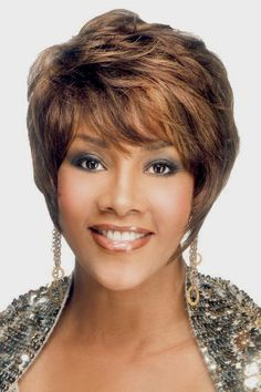The by Vivica Fox is a dramatic short, human hair wig. This wig is a pixie cut style, that has layers all over which tapers towards the ends and comes to the point along the jaw line. Vivica Fox, Short Pixie Haircuts, Short Black Hairstyles, Afro Hairstyles, Hairstyles 2016, Hairstyles Pictures, Trendy Hairstyles, Pixie Cut Styles, Short Hair Styles