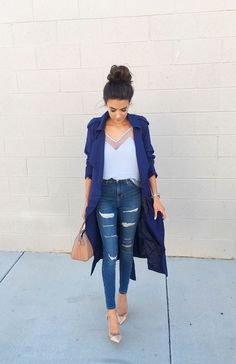 Distressed denim and a royal blue trench