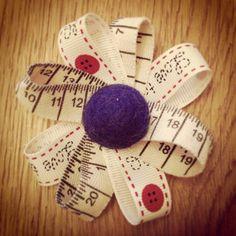 Tape measure ribbon flower