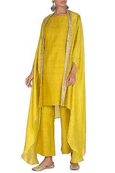 A deep yellow kurta in raw silk base. It is paired with matching boot-cut pants including organza and art silk cape having sequins, cutdana and zari embroidery. Party Wear Indian Dresses, Designer Party Wear Dresses, Dress Indian Style, Indian Designer Outfits, Indian Outfits, Designer Clothing, Silk Kurti Designs, Kurta Designs Women, Stylish Dress Designs