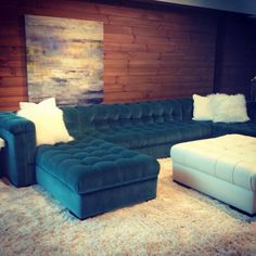 Double Chaise Sectional in a Teal Velvet...with tufting all over it,..ottoman matches the accent pillows...lovely!