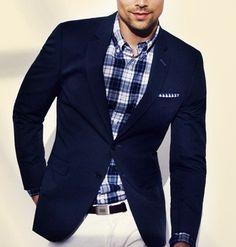 Navy blazer, navy plaid dress shirt with white slacks and navy plaid pocket square.