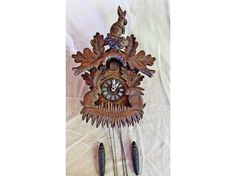 Excited to share this item from my shop: Cuckoo Clock Vintage Coo Coo Rabbits Black Forest Carving Wood Weights Carved