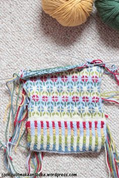 top down view of many coloured knitted mittens