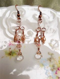 Sweet, Dainty, and Petit, Victorian Wedding Drop Earrings for the Bride! These earrings are created with rose gold enameled copper wire frames, with faceted quartz crystal center drops, clear aurora borealis crystals, tiny peachy copper wire wrapped rice pearls and clear aurora borealis glass seed beads. The earrings are completed with copper ear wires.  These earrings measure 2 in length from the top of the ear wires to the end of the quartz crystal drop, and 1/2 in width.   These earr...