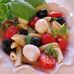 This cold pasta is tossed with tomatoes, olives, and fresh mozzarella for a light, Italian-inspired meal.  Allrecipes.com