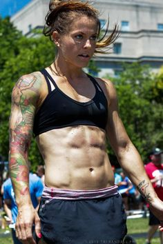 Christmas Abbott, one of the best bodies out there...in my opinion. Her physique is my goal. Oh, and she's now the first and ONLY woman on a NASCAR pit crew. Get it!