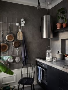 Beautiful black and concrete kitchen in industrial and scandinavian style.