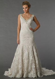 Danielle Caprese for Kleinfeld 113070 - This A-line gown features a v-neck neckline with in lace. It has a chapel train and a tank top.