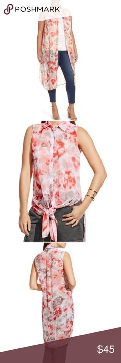 Two by Vince Camuto Floral Print Sleeveless Tunic This is a Two by Vince Camuto Floral Print Sheer Sleeveless Tunic. Size: XS. Color: Ivory. MSRP $89. Blurry blooms washed in pinkish coral tones refresh a shirt-style sleeveless tunic cut from airy, crinkled chiffon. Deeply slit sides add breezy movement and allow you to tie the front hem at the waist for a contemporary high/low look. * Front button closure. * Point collar. * Sleeveless. * 100% polyester. * Machine wash cold, tumble dry low…