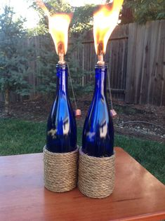 2 Outdoor Cobalt Blue Nautical wine bottle tiki torch by IlluminusCreations Great for spring time!