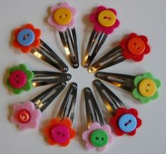 button flower hair clip by Rachel Lee