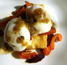 (made this up due to left over polenta from last night's BBQ lamb shanks over polenta): Poached eggs, sauteed orange pepper & purple onion atop firm polenta square; topped with Trader Joes new Hatch Chile salsa.  This is SOOOO good.  kind of a California take on huevos rancheros.  Highly recommend this new salsa & this as a great way to use left over polenta