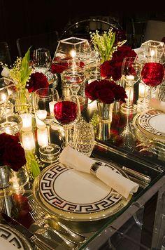 Decorating a holiday or reception table with red roses is instantly chic when paired with black accents.