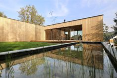Image 2 of 28 from gallery of L House / Juri Troy Architects. Photograph by Juri Troy Wooden Facade, Wooden Room, Geothermal Energy, Timber House, Floor To Ceiling Windows, Wall Cladding, Minimalist Home, Great View, Building Design