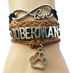 Personalized Photo Charms Compatible with Pandora Bracelets. Show your love for your Doberman with this awesome bracelet with adorable paw print pendant! Buy this bracelet now!