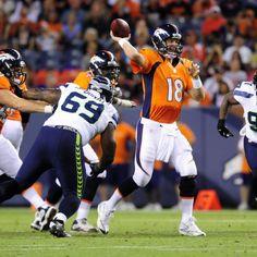 Peyton prepares to throw a pass against tough Seattle defense action