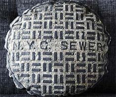 Manhole cover pillow - because I totally want to put something that says sewer on my couch...