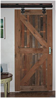 DIY Interior Sliding Barn Door on the Cheap - to separate pantry/laundry room from kitchen