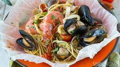 Infuse pasta with seafood flavors by baking your dinner in parchment pouches