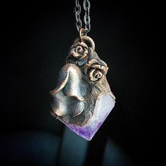 A personal favorite from my Etsy shop https://www.etsy.com/listing/456766110/amethyst-crystal-point-and-flower
