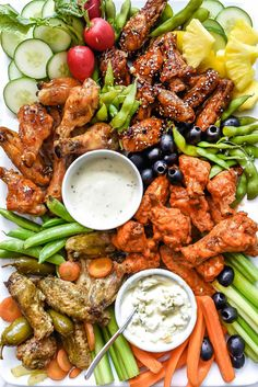Healthier crispy baked chicken wings are dressed in four different sauces and teamed up with all the dips for a chicken wing platter that's sure to score.