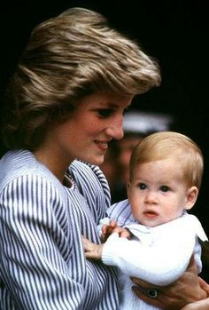Princess Diana holding Prince Harry