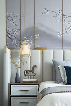 lavender cherry blossom mural behind channel tufted headboard in this serene bedroom