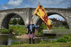 Eddie McNeill from the Wallace Soiciety attends attend a ceremony at the Stirling Bridge Battle Site as the Saltire was raised for the first time in 700 years on May 29, 2015 in Stirling, Scotland. Around two hundred people attended the unveiling of first ever joint memorial to honour the Guardians of Scotland, William Wallace and Andrew de Moray, at site of historic victory at Battle of Stirling Bridge.