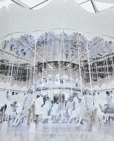Models entered the show on a huge pastel catwalk-turned-carousel for Louis Vuitton S/S 2012