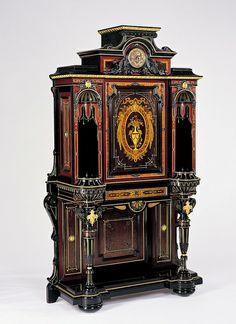 19th-Century American Decorative Arts: Unknown maker, probably New York, New York, Cabinet, ca. 1865-75 Ebonized cherry, eastern white pine, mahogany, tulipwood, amaranth, bird's-eye maple, marquetry of various woods, gilded bronze, unidentified metal, gilding 87 x 52 1/4 x 20 3/8 in. Museum Purchase