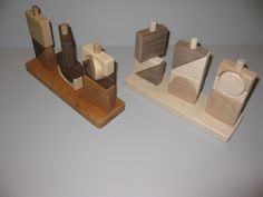 Three post puzzle toy. Natural or finished with non-toxic food grade wax. $30.00