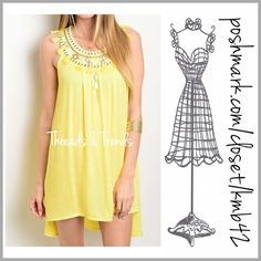 Fresh Spring Yellow Tunic Dress Brighten up your spring in this fresh yellow sleeveless tunic dress. Featuring a tassel and bead detail neckline. Made of rayon. Size S, M, L Threads & Trends Dresses