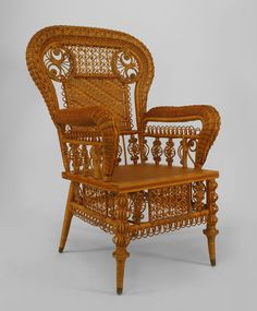 American Victorian pre-1897 ornate natural wicker arm chair with woven panel back, and filigree trim (HEYWOOD BROS. label) Heywood Brothers was established in 1826,  produced wicker and rattan furniture in the late 19th century. Wakefield initiated its mechanized production.[3] The wicker styles drew on the Aesthetic Movement and Japanese influences; simpler designs arose in the wake of the Arts and Crafts Movement. Merged with Wakefield Company 1897.
