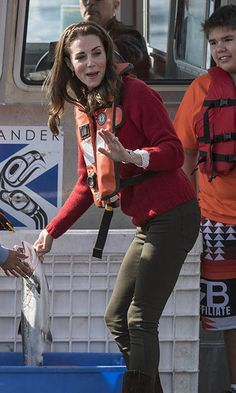 Kate wasn't afraid to get her hands dirty while tending to the fish. <br><br>Photo: Christopher Morris/Hello! Canada