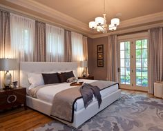 open Luxury Master Bedroom | flat bed bedroom chandelier patio doors windows