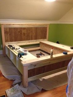 DIY bed with storage cubbies or drawers by marcia