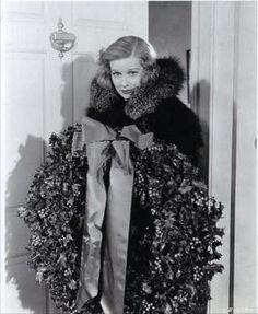 Lucille Ball hangs a wreath