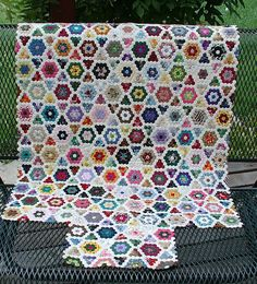 Mini hex quilt by sunshine's creations.   this is a minuture hex grand mothers flower garden quilt. The hexagons are 1/4 inch per side there are over 5500 pieces in this quilt 8 years in the making ( 5 years of which it was in storage) blogged here sunshinescreations.blogspot.com/2006/10/how-many-pieces-d... sunshinescreations.blogspot.com -------------------------------    Beautiful, this person deserves a Blue Ribbons. So wow !  Love this !  Would like to do one day--TD.