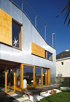 Mabire-Reich's Landscape House features metal walls and a sloping roof terrace