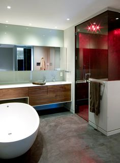 http://www.mxina.xyz/wp-content/uploads/2014/09/bathroom-fascinating-bathroom-interior-design-with-oval-white-bathtub-and-wooden-vanity-including-sink-and-wide-mirror-also-white-wall-paint-and-smoked-glass-shower-enclosure-with-red-light-decor-32-960x1304.jpg