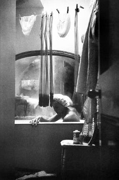 Eve Arnold. A girl who shares a bath and flat with three other girls, London, 1961.