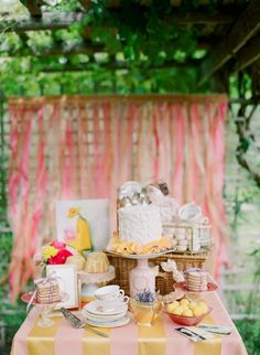 So pretty! Garden dessert table display with pink and gold table cloth and vintage tea cups and servers #wedding #vintage #gardenparty #desserttable #gold