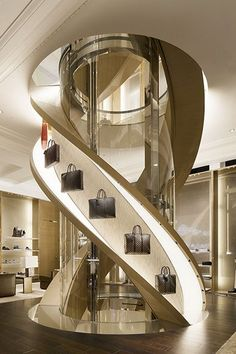feature design floor to ceiling brass decoration for Louis Vuitton handbag