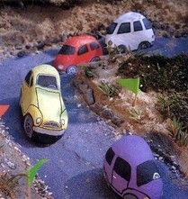 These painted rock cars would look great in a children's garden.