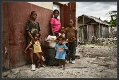 A typical family in Port-au-Prince, Haiti:  The single mother Pierre Jeanne (29) and his children. She earned their money by soap she sold on the streets. The fathers of their children don't support her.